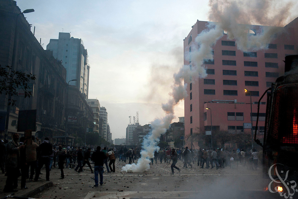 Tear gas is fired on Egyptian protesters marching down Ramsis street during massive and unprecedented demonstrations January 28, 2011 across Cairo, Egypt . The protests, inspired by the recent revolution in Tunisia, have struck a chord with Egypt's population, tired of inflation, high unemployment and alleged corruption within the Mubarak government..Slug: Egypt.Credit: Scott Nelson for the New York Times