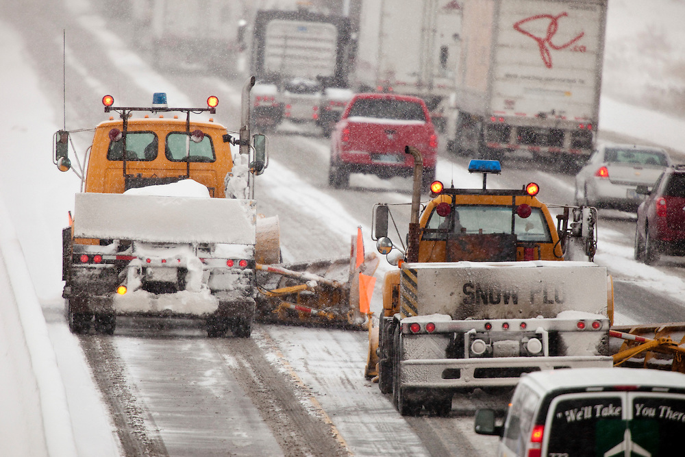 Snowplows work to clear the eastbound lanes of  Highway 401 near Woodstock, Ontario December 8, 2010. The region has been pummelled by snow squalls for 3 days with some areas receiving over 1.5 metres of snow.<br /> The Canadian Press/GEOFF ROBINS
