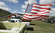 The American flag flies from the bed of &quot;Old Yeller,&quot; a 1959 Chevy Apache pickup. In the background is the new Eastern Washington Agricultural Museum. <br />