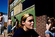 Lisa Russel, 20, and other teens hang out on the street corners in Glouster, Ohio on Saturday, May 24, 2008. Glouster was once a thriving community in Southeastern Ohio, but with the departure of extractive industries such as coal mining the town's economic sources dried up. The town youth have little to do and substance abuse runs rampant.