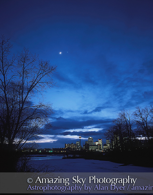Moonb and Venus over Calgary skyline, March 24, 2004. Taken from south Zoo parking lot overlooking Bow River and downtown Calgary. <br /> <br /> Taken with Pentax 6x7 camera and 55mm lens on fixed tripod. Fujichrome 100F slide film, and about 4 second exposure. Some haze dimmed Moon and Venus. Very little adjustment to contrast and color.