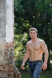 shirtless muscular All American man walking outdoors