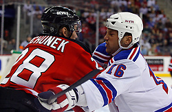February 1, 2008; Newark, NJ, USA;  New York Rangers left wing Sean Avery (16) hits New Jersey Devils defenseman Karel Rachunek (28) during the first period at the Prudential Center in Newark, NJ.