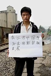 Xu Ai Hua - 19 Yrs.<br /> High school graduate.<br /> Yunnan Province.<br /> <br /> 'I think China's economy will continue to develop forward'.