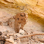 Ancient Puebloan site in Southern Utah.  This site has a roof beam visible in the foreground, perhaps part of a kiva roof.  These sites were abandoned in the 12th and 13th centuries.