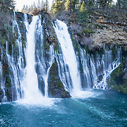 Burney Falls is a beautiful National Natural Landmark on Burney Creek in McArthur-Burney Falls Memorial State Park, Shasta County, California, USA. The water comes from underground springs above and at the falls, which plunges 129 feet. The waterfall was named after pioneer settler Samuel Burney who lived nearby in the 1850s. The McArthurs settled nearby in the late 1800s and their descendants saved the waterfall from development, bought the property and gifted it to the state in the 1920s. The park is northeast of Redding, six miles north of Highway 299 on Highway 89 near Burney. The Pacific Crest Trail passes through the park. This panorama was stitched from 3 overlapping photos.