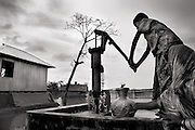 To adapt in the climate change, structure of the house and tube-wells are being made on the high base. Image © Mohammad Rakibul Hasan/Falcon Photo Agency