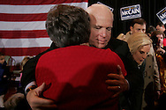 Republican presidential candidate U.S. Senator John McCain hugs an audience member during a campaign stop in Aiken, South Carolina January 17, 2008.
