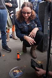 , August 4th 2014. Third generation British Jew Sonya Levine renounces her Israeli citizenship and burns her Israeli passport  to show her disgust at their ongoing attacks against  Gaza.
