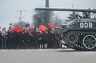 Pyongyang citizens cheer while a tank parades along one of the city's long avenues, during the celebrations marking Kim il-Sung's 100th birthday, on April 15, 2012. According to Korea Institute of Defense Analyses (KIDA) North Korea is spending about a third of its national income on its military, a much larger amount than announced, as it builds its forces despite a struggling economy. The DPRK's military first is at the expense of its moribund closed economy. A number of years ago, North Korea embarked on a program of uranium enrichment, giving it a route to a nuclear bomb. North Korea is the most militarized country in the world today.