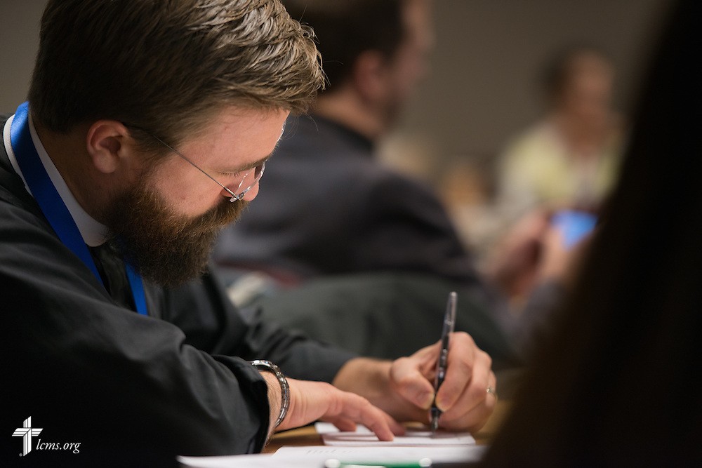 The Rev. Roy Askins jots notes during a missionary orientation session at The Lutheran Church–Missouri Synod International Center on Tuesday, March 3, 2015, in Kirkwood, Mo. LCMS Communications/Erik M. Lunsford