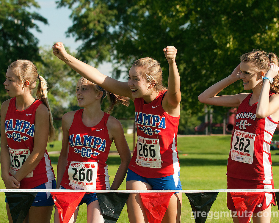 Nampa girls (L to R: Andee Oord, Alyssa Hixon, Sarah Needs, and Faith Homer) cheer on the boys team during the Roger Curran Invitational at West Park in Nampa, Idaho on September 14, 2013.