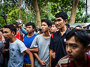 03 SEPTEMBER 2016 - BANGKOK, THAILAND:  Residents of Pom Mahakan link arms to keep out Bangkok city officials. Hundreds of people from the Pom Mahakan community and other communities in Bangkok barricaded themselves in the Pom Mahakan Fort to prevent Bangkok officials from tearing down the homes in the community Saturday. The city had issued eviction notices and said they would reclaim the land in the historic fort from the community. People prevented the city workers from getting into the fort. After negotiations with community leaders, Bangkok officials were allowed to tear down 12 homes that had either been abandoned or whose owners had agreed to move. The remaining 44 families who live in the fort have vowed to stay.     PHOTO BY JACK KURTZ