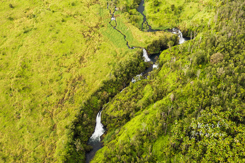 Aerial photo over  waterfalls, Hilo Watershed Forest Reserve, Big Island, Hawaii