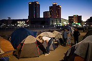 RENO, NV - OCTOBER 6:   A tent city for the homeless sits in the shadow of high-rise casinos in downtown Reno, Nevada October 6, 2008. The City of Reno set up the tent city when existing shelters became overcrowded as Nevada struggles with one of the highest unemployment rates in the country. (Photo by Max Whittaker/Getty Images)