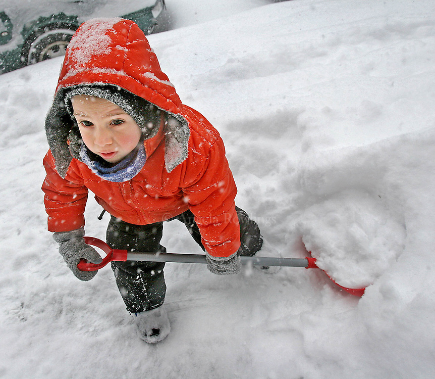 02/12/06 Boston, MA-- Lucas Rothman, 3, helps his mom to shovel snow in front of their Jamaica Plain home Sunday.  (021206snowar02, saved in mon, Staff Photo by Angela Rowlings)