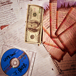 Money, lyrics and a demo CD on the table at a recording session with the Blue Collar Boys.
