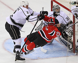 June 2; Newark, NJ, USA; Los Angeles Kings defenseman Matt Greene (2) crosschecks New Jersey Devils center Ryan Carter (20) during the first period of the 2012 Stanley Cup Finals Game 2 at the Prudential Center.