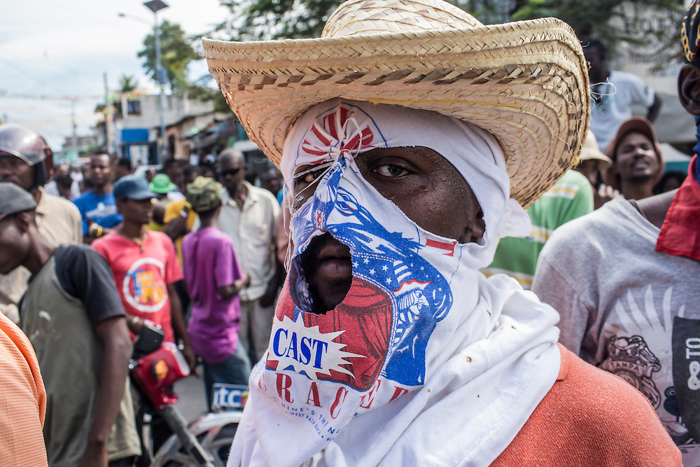 An anti-government protester on Tuesday, December 16, 2014 in Port-au-Prince, Haiti. President Michel Martelly was elected in 2010 with great hope for reforms, but in the wake of slow recovery and parliamentary elections that are three years overdue, his popularity has suffered tremendously, forcing Prime Minister Laurent Lamothe to resign.