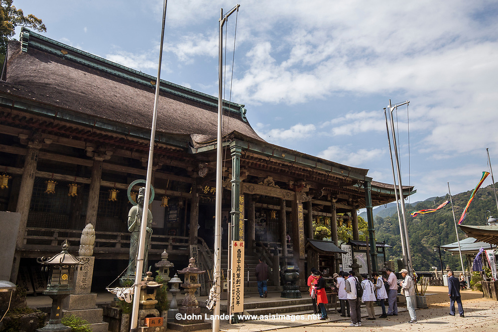 Kumano Nachi Taisha Shrine is a part of the UNESCO World Heritage Sacred Sites and Pilgrimage Routes in the Kii Mountain Range of Japan. The Kumano Kodo route connects it to Hongu Taisha Shrine, Hayatama Taisha Shrine, and Koya-san Wakayama Prefecture.  Even today Japanese henro pilgrims trek these routes, visiting these historically important shrines and temples.  Serious henro travel to all three sites to complete their pilgrimage. Kumano Nachi Taisha is surrounded by cedar forests, a sacred camphor tree and is located next to Tach Waterfall and Seigantoji Temple Pagoda.