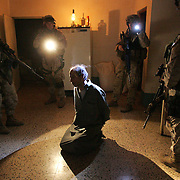 2 December 2004.Mahmudiyah, Iraq..US Marine raid homes of suspected insurgents...After a tip off from an Iraqi informant US Marines staged a nightime raid against suspected insurgents in the town of Mahmudiyah a hotbed of anti-occupation activity. The targets were suspected of being involved at a high level with the planning and executing of IED (Improvised Explosive Device) attacks against coalition forces....To accompany copy slugged 'RAID' by John Burns.