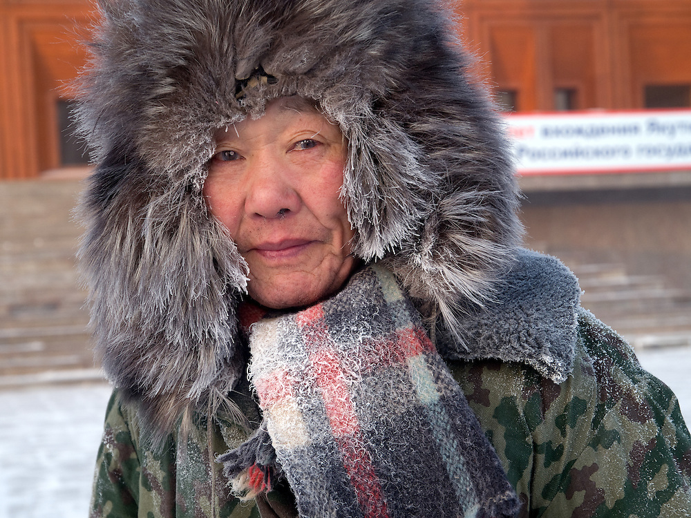 Street portrait of a Yakutsk inhabitant protected with the traditional fur cap and warm clothing against the extrem cold. Yakutsk is a city in the Russian Far East, located about 4 degrees (450 km) below the Arctic Circle. It is the capital of the Sakha (Yakutia) Republic (formerly the Yakut Autonomous Soviet Socialist Republic), Russia and a major port on the Lena River. Yakutsk is one of the coldest cities on earth, with winter temperatures averaging -40.9 degrees Celsius.