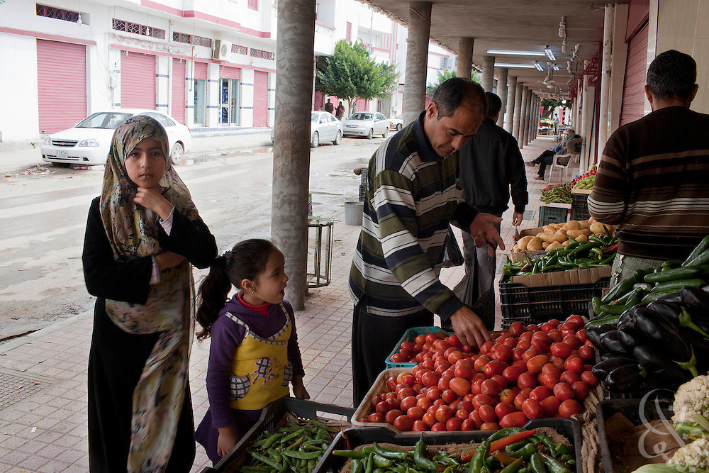 A Libyan family shops for fresh produce February 23, 2011 in Darna, Libya. Libya tightened its grip on the capital, tripoli, but the rest of the country appeared to be slipping further out of his control. Towns in the east appear calm and are being described as under the full control of opposition gunmen. .Slug: Libya.Credit: Scott Nelson for the New York Times