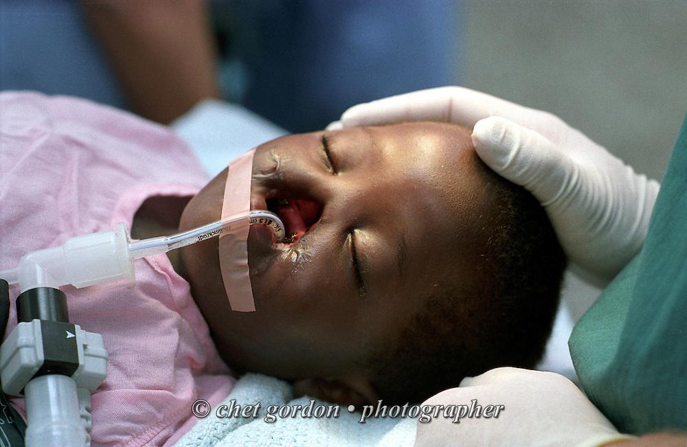 NAIROBI, KENYA.  Nine year old Kenyan patient Esther is prepared for a dental extraction in the operating room at Kenyatta National Hospital in Nairobi, Kenya on November 15, 2001.