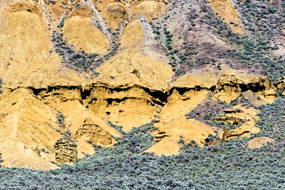Rock formations and sagebrush in the rocks at Lac du Bois Provincial Park near Kamloops, British Columbia, Canada