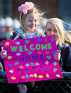 Emily Templeton 4, from Dundee, and her mother Kirsty wait patiently for her father, Leading Hand Calum Templeton to return home aboard the type 23 frigate HMS Richmond at Portsmouth Royal Navy Base following a seven-month deployment to the South Atlantic. Picture date: Friday 21st February, 2014. Photo credit should read: Christopher Ison. Contact chrisison@mac.com 07544044177