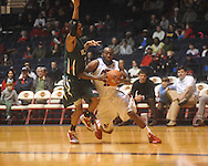 "Ole Miss guard Chris Warren (12)  dribbles past Mississippi Valley State's Terrence Joyner (3) at C.M. ""Tad"" Smith Coliseum in Oxford, Miss. on Monday, December 13, 2010."