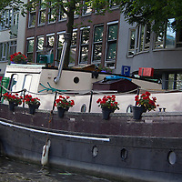 Europe, Netherlands, Amsterdam. Canal Houseboat, Amsterdam.
