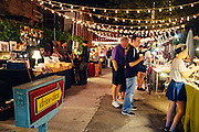Shoppers peruse Frenchmen Art Market at night in the Marginy, New Orleans