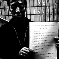 BEIJING, DECEMBER-22:  a man shows a witness narration re a family member that was beaten to death..Hundreds of thousands of Chinese have descended upon Beijing in the past decades hoping to get the attention of higher authorities for cival law cases reaching from work accidents, violence against family members, murder,  money extorsion and which in the majority reveal a corrupt rural legal system...The tradition of  appealing to higher authorities  in the capital reaches back to imperial times . In Beijing , petitioners villages where people would congregate in cheap housing, outside the city centre were common. These days though, petitioners increasingly face tremendous obstacles to get heard : provincial as well as undercover police try to stop petitioners from going to the National Petition offices to file law suites . If caught, they are briefly sent to an unoffical detention centre where they wait for the train ride back to the province.  In addition  the number of villages has been reduced significantly as the preparations for the 2008 Olympics progress. Many fear they will be all gone  by summer 2008. ..