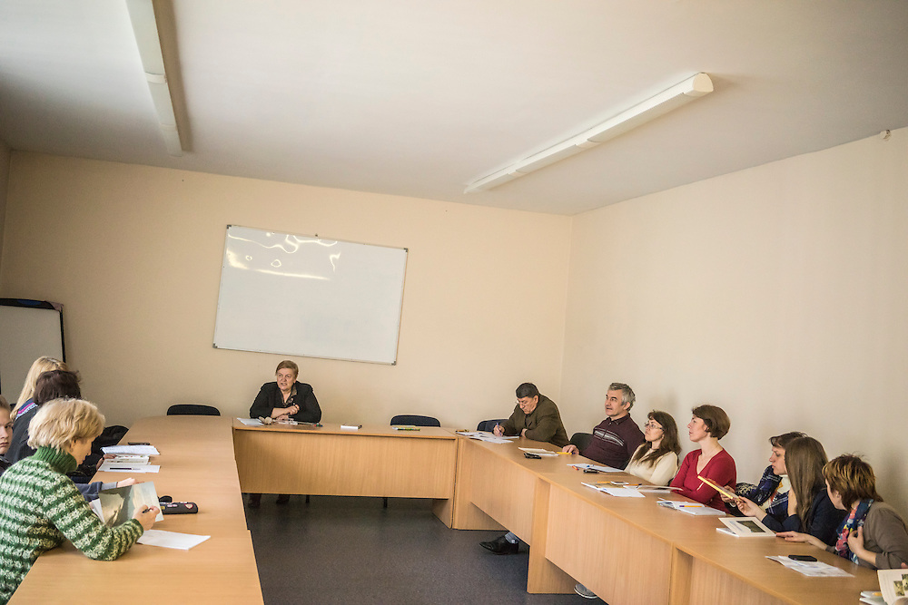 Ewa Holodkova, 67, second from left, from the town of Stakhanov in Lugansk oblast, teaches a Polish language class to students of whom many are IDPs from eastern Ukraine on Tuesday, April 28, 2015 in Lviv, Ukraine. Despite being a Polish citizen and she and her husband having the legal right to live in Poland, where they have a daughter, their Ukrainian pensions are too small to afford life in Poland. CREDIT: Brendan Hoffman/Prime for the Wall Street Journal UKRMIGRATION CREDIT: Brendan Hoffman/Prime for the Wall Street Journal UKRMIGRATION