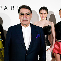 BEIJING, MAY-22 :  Alain Hivelin, CEO of Balmain , poses for an exclusive portrait with three models  wearing  spring/summer 2013 collection outfits.
