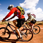 Mountain bikers Brad Barlage and Katie Caviccio ride the White Rim Trail in Canyonlands National Park, Southern Utah.