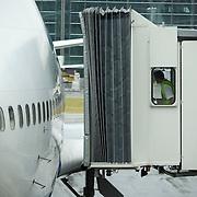 British Airways jetty operator carefully manoeuvres towards arrived BA aircraft door at Heathrow's Terminal 5.  .