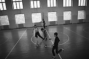 "Young group of soccers playing in Shushis new renovated sports hall. This image is part of the photoproject ""The Twentieth Spring"", a portrait of caucasian town Shushi 20 years after its so called ""Liberation"" by armenian fighters. In its more than two centuries old history Shushi was ruled by different powers like armeniens, persians, russian or aseris. In 1991 a fierce battle for Karabakhs independence from Azerbaijan began. During the breakdown of Sowjet Union armenians didn´t want to stay within the Republic of Azerbaijan anymore. 1992 armenians manage to takeover ""ancient armenian Shushi"" and pushed out remained aseris forces which had operate a rocket base there. Since then Shushi became an ""armenian town"" again. Today, 20 yeras after statement of Karabakhs independence Shushi tries to find it´s opportunities for it´s future. The less populated town is still affected by devastation and ruins by it´s violent history. Life is mostly a daily struggle for the inhabitants to get expenses covered, caused by a lack of jobs and almost no perspective for a sustainable economic development. Shushi depends on donations by diaspora armenians. On the other hand those donations have made it possible to rebuild a cultural centre, recover new asphalt roads and other infrastructure. 20 years after Shushis fall into armenian hands Babies get born and people won´t never be under aseris rule again. The bloody early 1990´s civil war has moved into the trenches of the frontline 20 kilometer away from Shushi where it stuck since 1994. The karabakh conflict is still not solved and could turn to an open war every day. Nonetheless life goes on on the south caucasian rocky tip above mountainious region of Karabakh where Shushi enthrones ever since centuries."