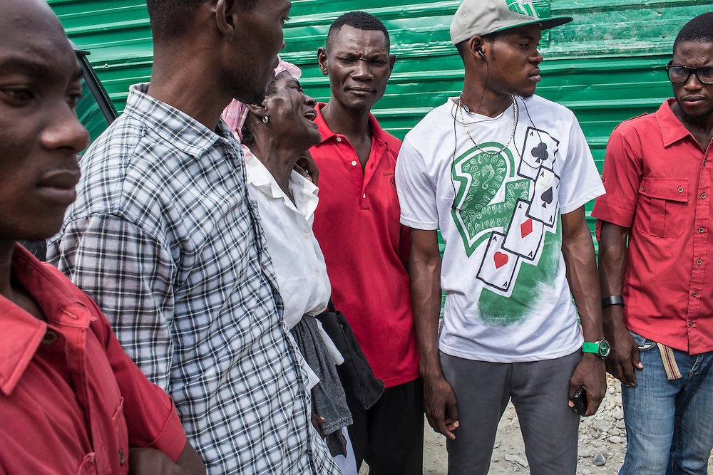 Claudiani Fonrose, center, surrounded by friends of her son, cries as the body of her son, Jolin Nicolas, 19, is retrieved from the morgue on Wednesday, December 17, 2014 in Port-au-Prince, Haiti. Jolin was killed by police while participating in an anti-government protest on December 13.