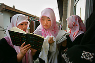 Young Muslim girls study at the Muslim Village Girl's School for Arabic Studies, in Wuzhong, China's Ningxia province Thursday Oct. 19, 2006.Women's well-established status in religious life is evident across Ningxia, a desert region whose oases along the Yellow River were settled by Muslim traders from the Middle East. Religious schools for girls are common. Ningxia's top Islamic institute can't keep up with the demand from women applicants. China's women imams serve as an inspiration to Muslim feminists and points to a more inclusive Islam at a time when much of the Islamic world is being driven by more austerely fundamentalist versions that largely relegate women to the home.