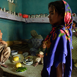 Mukhtar Mai, 33, sits with family members inside the room where two of her female body guards currently reside, Meerwala, Pakistan, April 27, 2005. Mai, went against the Pakistani tradition of committing suicide when she brought charges against the men who gang raped her nearly three years ago. With money from the ruling she opened two schools, one for girls, the other for boys. Mai cited that education is the only thing that will stop such acts from happening.