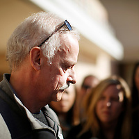 Bill Heilman, husband of Suzie Heilman talks to reporters outside the hospital where his wife is recovering in Tucson, Arizona January 10, 2011. Suzie is the woman who brought 9-year-old Christina-Taylor Green to the event where she was fatally shot. Suzie sustained 3 gunshot wounds herself. REUTERS/Rick Wilking (UNITED STATES)