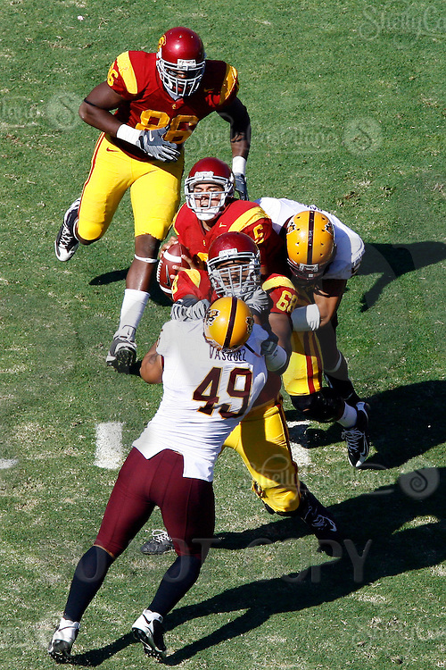 11 October 2008: Quarterback #6 Mark Sanchez with the football getting sacked elevated view during the NCAA Pac-10 USC Trojans 28-0 shut-out win over the Arizona State University Sun Devils during a day college football game at the Los Angeles Memorial Coliseum in Southern California.