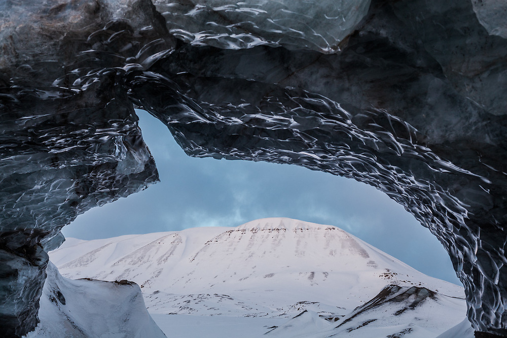 Large ice arch on the surface of Tellbreen, Svalbard.