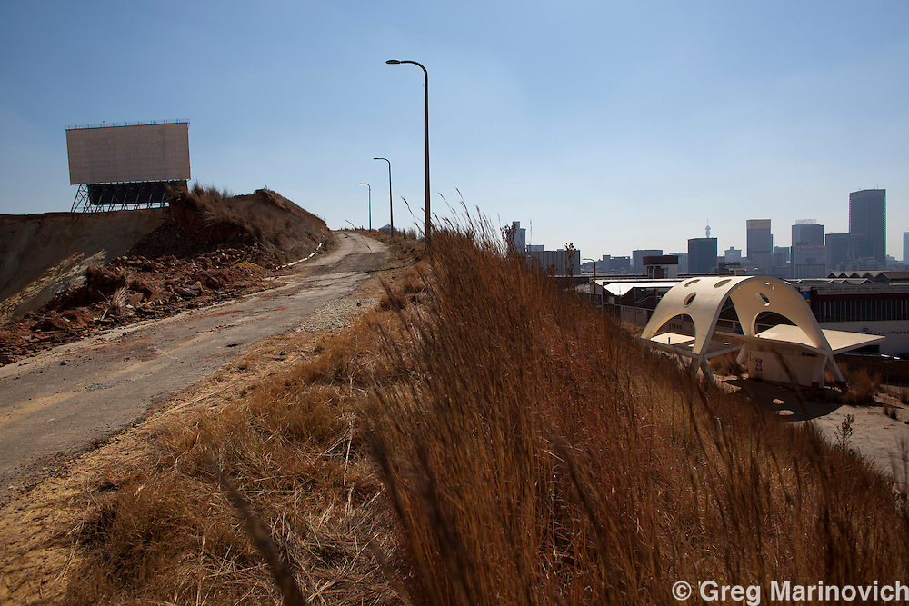 The johannesburg landmark, the Topstar Drive-in has been sacrificed to mammon - the gold dump that it was built on has been re-mined for the gold left over from Joburg's early mining days extraction technology. Johannesburg - the city of Gold. August 12, 2010. Photo Greg Marinovich / StoryTaxi.com