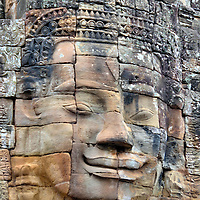 Introduction of Bayon in Angkor Archaeological Park, Cambodia<br /> Shortly after defeating the Cham in 1178, Jayavarman VII became King of the Khmer Empire and launched a massive building campaign. His first project was Bayon located within an area now called Angkor Thom. It was initially a Buddhist temple but later became Hindu. This state temple was structured to resemble Mount Meru, the intersection of heaven and earth. The archeological gem is famous for its 216 giant stone faces on the 37 remaining towers. Originally, there were 49 prasats.