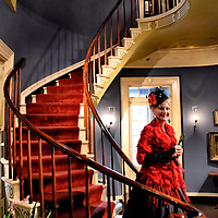 Southern Belle on Curved Staircase in a Plantation in Darrow, Louisiana<br /> The grand old south is still alive among the 140 Louisiana plantations that are now National Historic Landmarks. Many of these gorgeous mansions offer guided tours by southern belles dressed in Antebellum hoop dresses. The properties have long, tree-lined driveways with immaculate gardens. The homes are decorated in their pre-Civil War splendor in sharp contrast to the squalor of the slaves&rsquo; quarters.