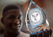 BEAUFORT, SC - JULY 14: CJ Cummings holds his Best Overall Lifter trophy  on July 14, 2014 in Beaufort, South Carolina, that he won at the 2013 Pan American Sub 15 Championships. Cummings, who is 5-foot-2, is part of a resurgence of interest in Olympic weightlifting in the U.S. (Photo by Stephen B. Morton for The Washington Post)
