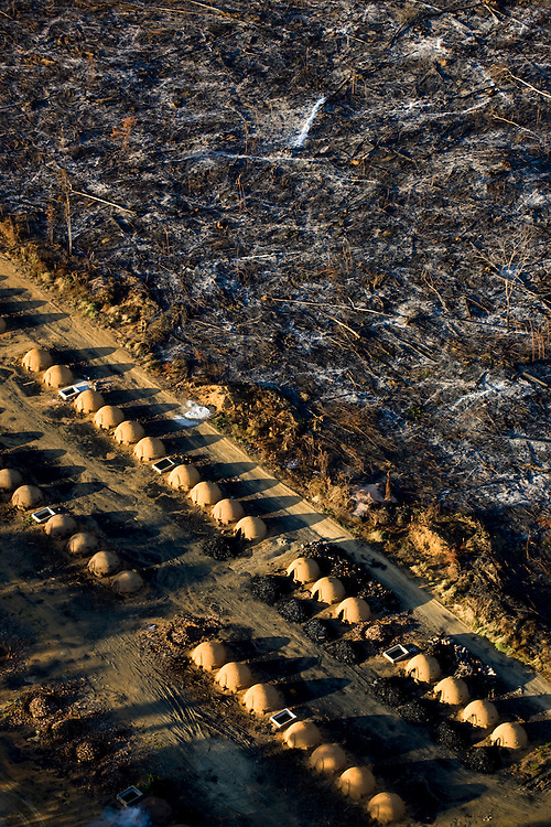 Charcoal ovens border land recently cleared of Amazon rainforest in Sao Felix Do Xingu Municipality, Para State, Brazil, August 12, 2008. .Daniel Beltra/Greenpeace